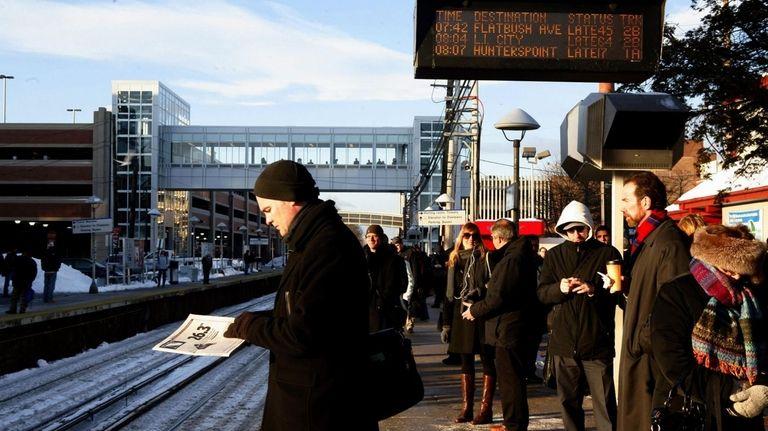 Commuters wait at the Mineola Long Island Rail