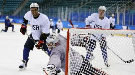 United State's goalie Brandon Maxwell reaches for a
