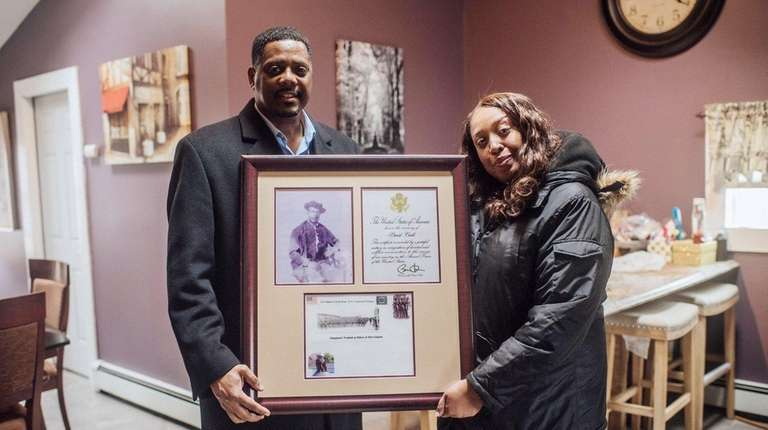 Cousins Francis S. Carl and Denice Evans-Sheppard hold