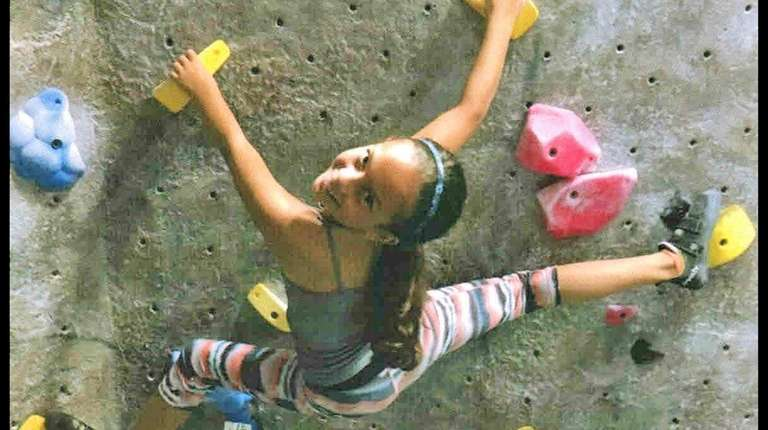 Kidsday reporter Ellie Brown climbs at Island Rock