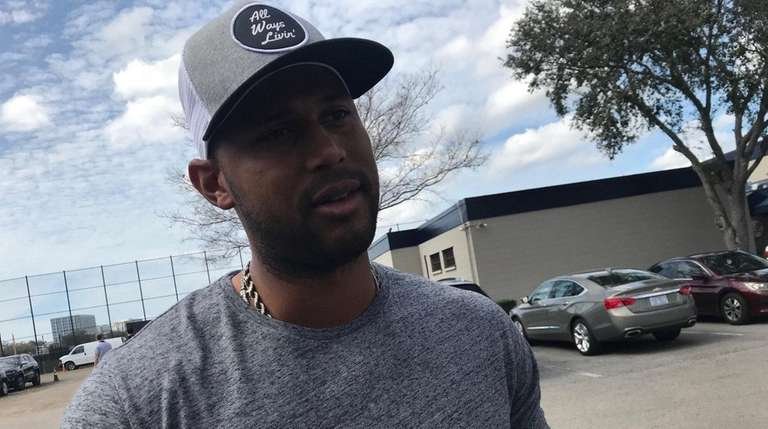 Yankees outfielder Aaron Hicks speaks to reporters after