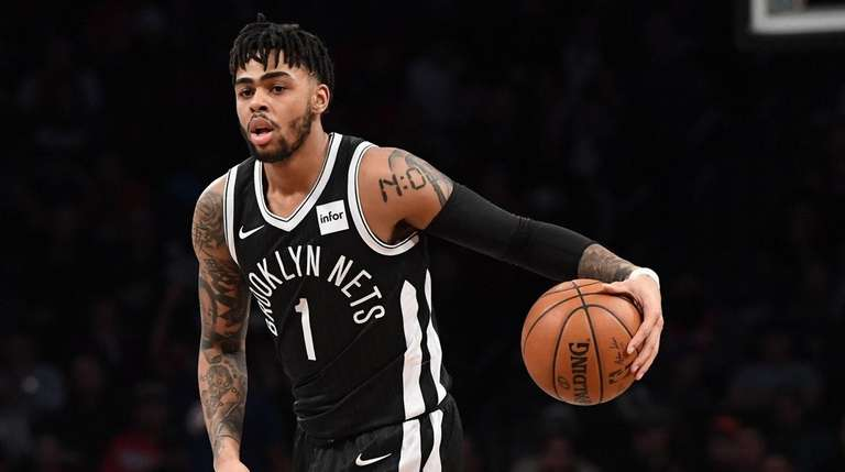 Nets guard D'Angelo Russell controls the ball against