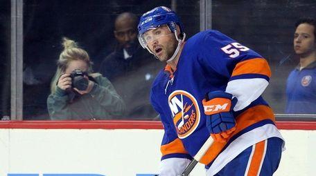 Islanders defenseman Johnny Boychuk plays the puck against