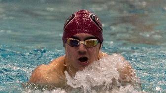 Garden City's John Protano competes in the boys