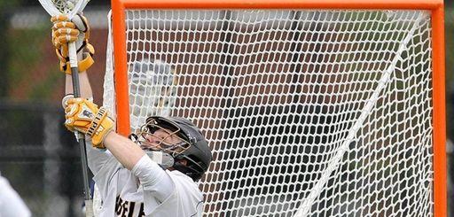 Adelphi's Brendan McDougal (11) makes a save during