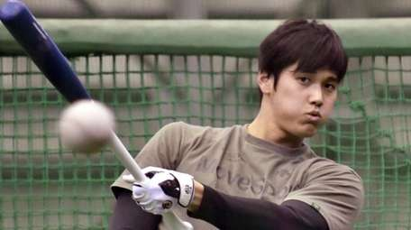 Los Angeles Angels-bound Shohei Ohtani practices during a