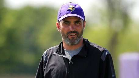Vikings quarterback coach Kevin Stefanski watches practice during