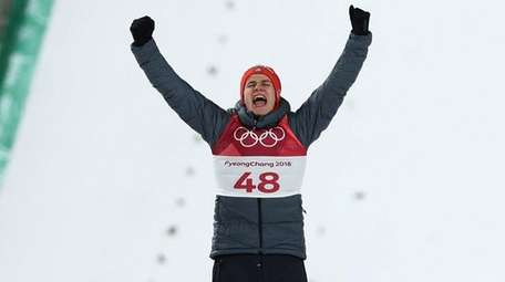 Gold medalist Andreas Wellinger of Germany celebrates during