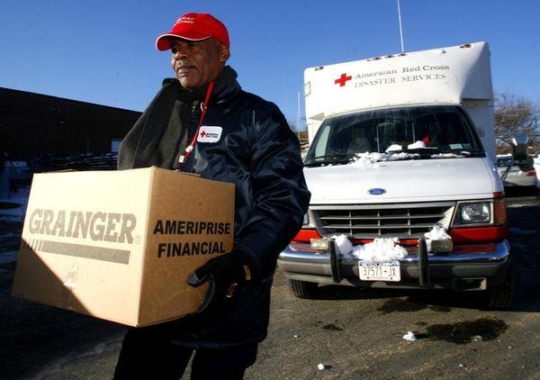 Ruthven Hoyte, a Red Cross Volunteer, packs trucks