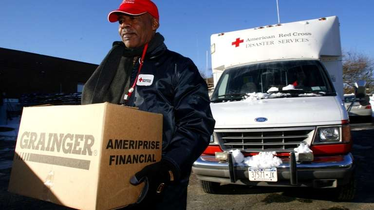Ruthven Hoyte, a Red Cross Volunteer, packs trucks