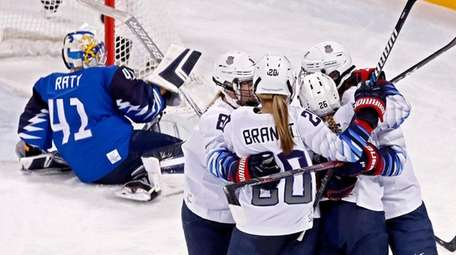 Kendall Coyne (C) of the USA celebrates with
