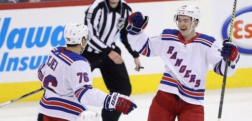Rangers' Brady Skjei (76), Steven Kampfer (47) and