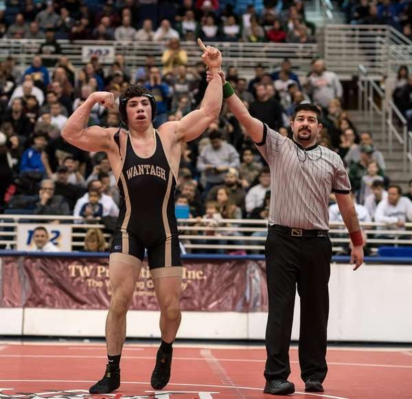 Wantagh's James Langan (left) celebrates his win over