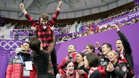 Scott Moir and Tessa Virtue of Canada celebrate