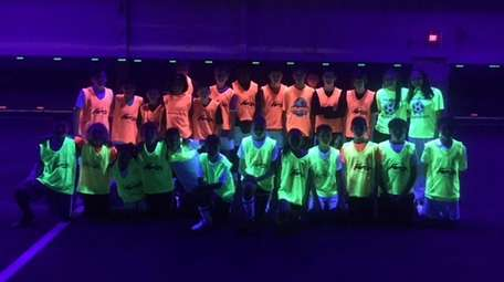 Glow-in-the-dark soccer play, for $15 and hour, is