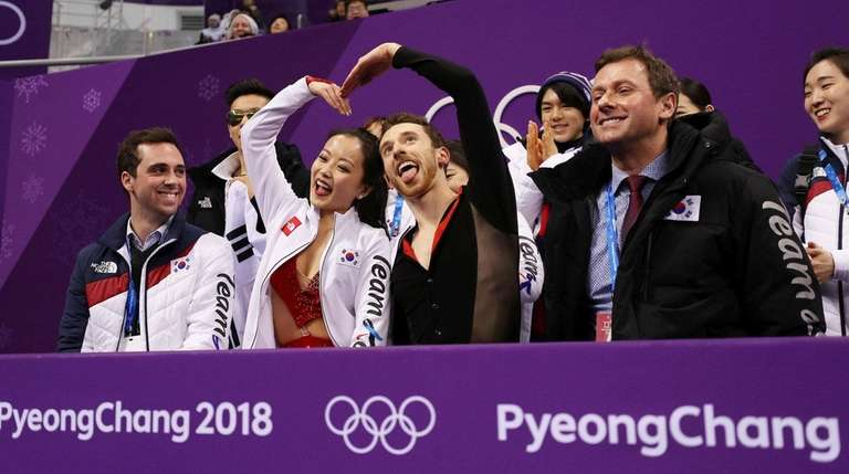 Yura Min and Alexander Gamelin after competing at