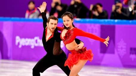 Alexander Gamelin and Yura Min compete in the