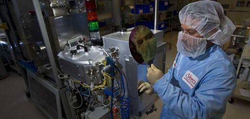 A mechanical engineer holds a data wafer near