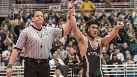Wantagh's Matthew Rogers (right), celebrates his win against