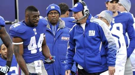 Ahmad Brdshaw, left, and Tom Coughlin have an