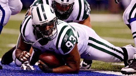 Jets' Marques Douglas scores a touchdown against the