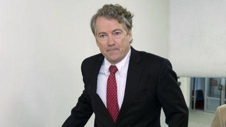 Sen. Rand Paul, R-Ky., walks to the Senate