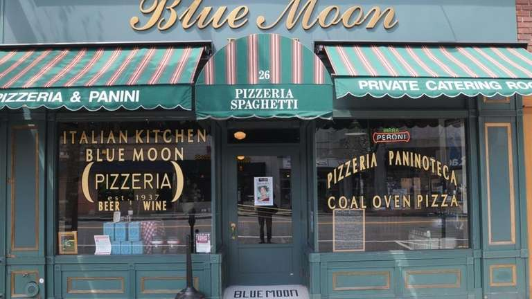 The exterior of the Blue Moon Pizzeria in