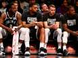The Nets bench looks on during the second
