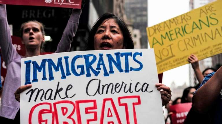 Demonstrators rally in support of the Deferred Action