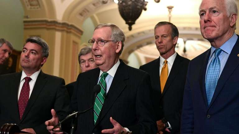Senate Majority Leader Mitch McConnell (R-Ky.), center, speaks