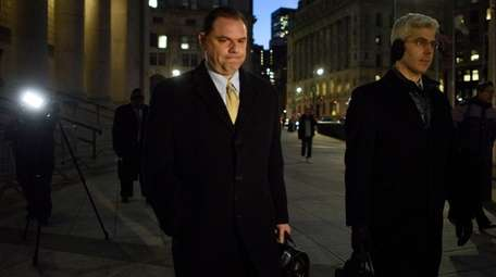 Joseph Percoco, center, exits a federal courthouse in