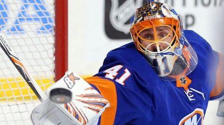 Islanders' Jaroslav Halak makes a save against the