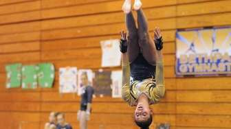 Julianna Feliz of Bethpage makes an inverted flip