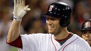 Boston's Jason Bay celebrates after hitting a two-run
