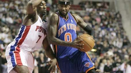 Knicks guard Larry Hughes, right, drives past Detroit