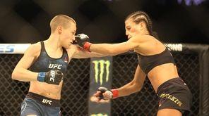 Rose Namajunas, left, and Joanna Jedrzejczyk exchange punches