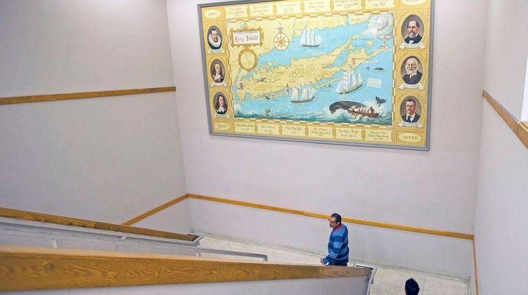 The massive mural of Long Island hangs in
