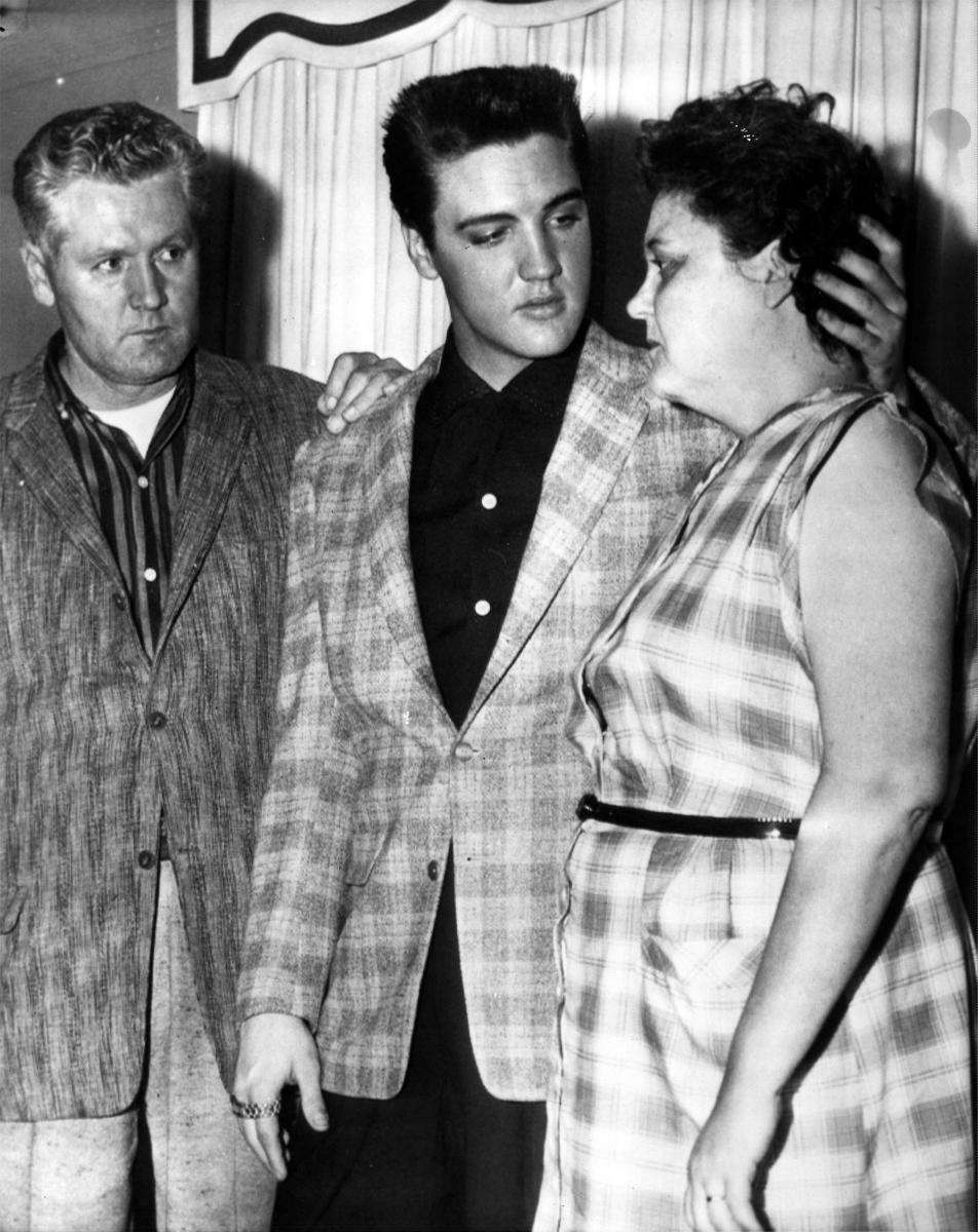 With his father Vernon Presley, rocker and movie