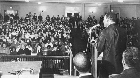 The Rev. Martin Luther King Jr. talks to