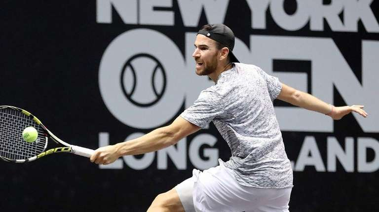 Adrian Mannarino makes the lunging backhand return against