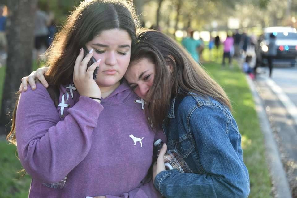 Students grieve outside Pines Trail Center after Wednesday's