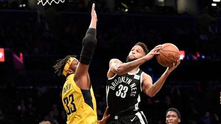 Allen Crabbe of the Nets goes up against