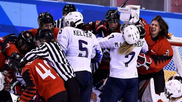 Players pile up on the Canadian goal in