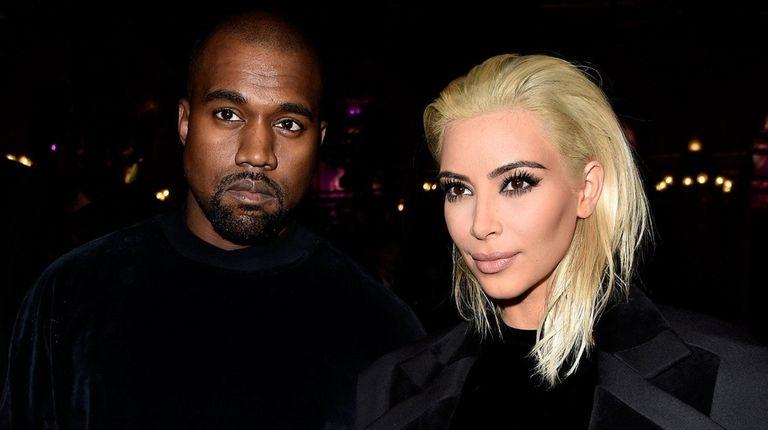 Kanye West and Kim Kardashian attend the Balmain