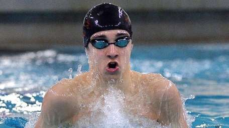 Half Hollow Hills' Ethan Tack swims in the