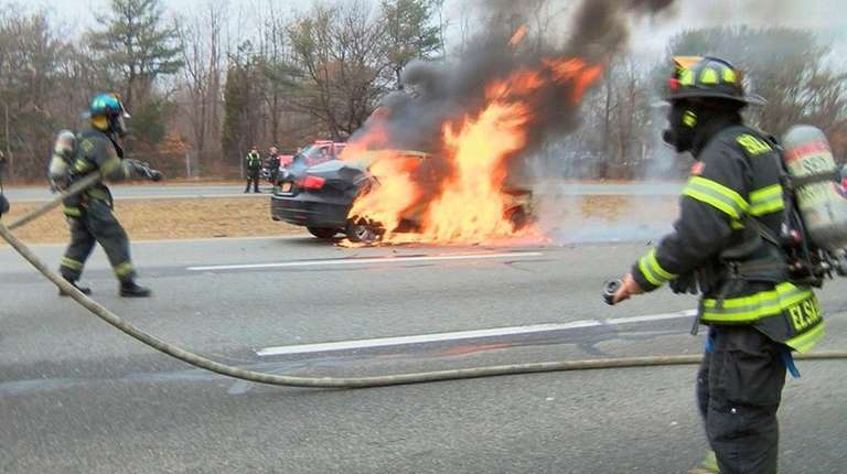 Firefighters respond to a crash and fire on