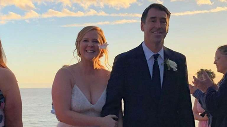Amy Schumer and husband Chris Fischer appear in