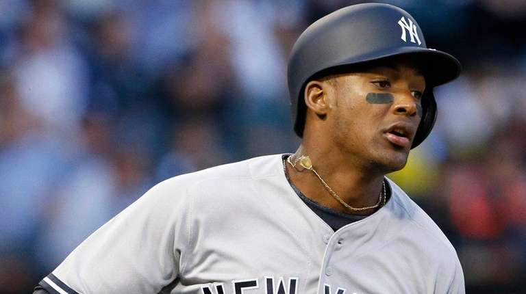 The Yankees' Miguel Andujar runs to first base