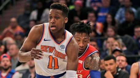 Knicks point guard Frank Ntilikina drives to the