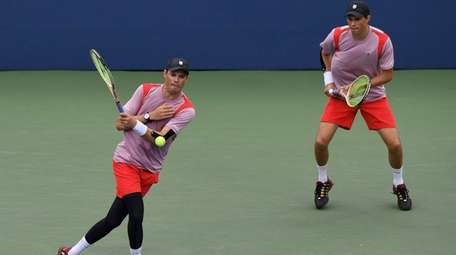 Bob Bryan and Mike Bryan play against against